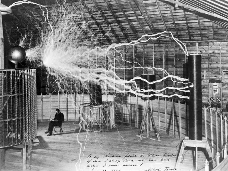 The inventor at rest, with a Tesla coil (thanks to a double exposure).